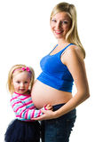 Pregnant woman with 2 yo daughter Stock Photos