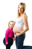 Pregnant woman with 2 yo daughter Stock Images
