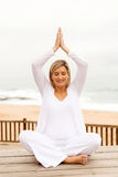Pregnant woman yoga stock photography