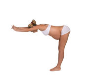 Pregnant woman in yoga posing Royalty Free Stock Photo