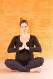 Pregnant woman yoga Stock Photo