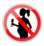 Pregnant women and alcohol. Red prohibition sign-pregnant woman with a glass of alcohol Stock Photo