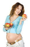 Pregnant women with apples Stock Image