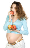 Pregnant women with apples Stock Photos
