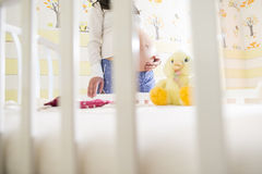 Pregnant women in a baby room. Royalty Free Stock Image