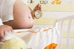 Pregnant women in a baby room. Stock Image