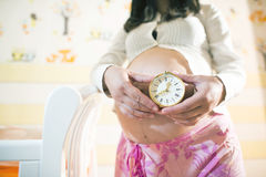 Pregnant women in a baby room. Stock Photo