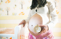 Pregnant women in a baby room. Stock Photography