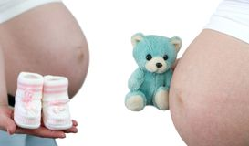Pregnant women and baby toys Stock Photography