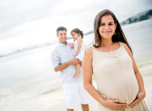 Pregnant woman with her family Stock Photography