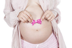 Pregnant women with bow. Royalty Free Stock Photography