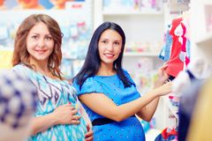 Pregnant women buying clothes for babies Royalty Free Stock Image