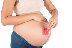 Pregnant Women With Clock. White background stock image