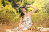 Pregnant women in the dry grass with ripe fruit Royalty Free Stock Photography