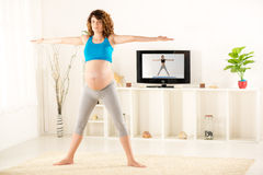 Pregnant Women Exercise Stock Photography