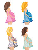 Pregnant women in fashion dresses Royalty Free Stock Photography