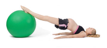Pregnant Woman Fitness. Exercise Ball Hip Raise Stock Image
