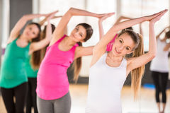 Pregnant women at gym. Stock Images