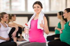 Pregnant women at gym. Royalty Free Stock Photo
