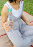 Pregnant women have a water bottle in hand. Pregnant women have a water bottle in hand to drink more water to the health of the baby Royalty Free Stock Image