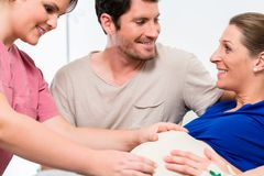 Pregnant woman and her man in delivery room. Pregnant women and her men in delivery room of hospital stock photo