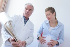 Pregnant woman holding womb. Pregnant women holding her womb stock photo