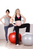 Pregnant women with large gymnastic balls Stock Photography