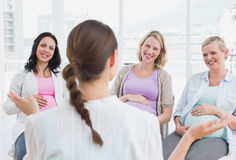 Pregnant women listening to doctor at antenatal class Stock Images