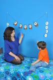 Pregnant women and little boy. Mother and son anticipate the new baby Stock Photos