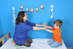 Pregnant women and little boy. Mother and son anticipate the new baby Royalty Free Stock Photos