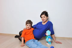 Pregnant women and little boy Stock Photos
