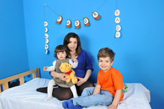 Pregnant women and little kids. Mother and children anticipate the new baby Stock Photo