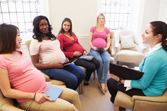 Pregnant Women Meeting At Ante Natal Class. Sitting Down Having A Discussion Royalty Free Stock Photography