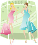 Pregnant women shopping. Two beautiful young pregnant women shopping Royalty Free Stock Photo