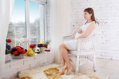 Pregnant women sit on a chair Royalty Free Stock Images
