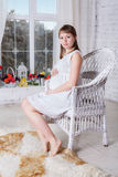 Pregnant women sit on a chair Stock Image