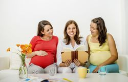 Pregnant women on sofa Stock Photos