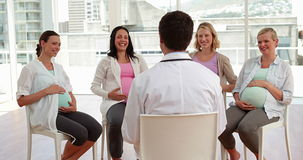Pregnant women talking together at antenatal class Royalty Free Stock Images