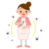 Pregnant women to spray insect repellent Stock Photography