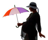 Pregnant women with umbrella. Silhouette of pregnant woman with color umbrella, isolated on white stock images