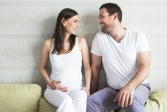 Pregnant couple indoors Royalty Free Stock Images