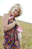 Pregnant wooman holding booties Royalty Free Stock Image