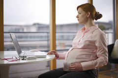 Pregnant and working variations Stock Photos