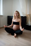 Pregnant yoga Stock Photos