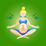 Pregnant yoga with baby Royalty Free Stock Photo