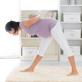 Pregnant yoga. Royalty Free Stock Photos