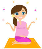 Pregnant yoga woman juggling with flowers Stock Photography