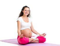 Pregnant yoga woman relaxing and meditating Royalty Free Stock Photo