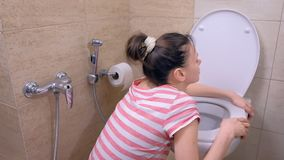 Pregnant young tired woman is vomiting in toilet sitting on the floor and drinking water. Pregnant young tired woman is vomiting in toilet sitting on the floor stock footage