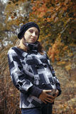 Pregnant young woman in autumn park Royalty Free Stock Image